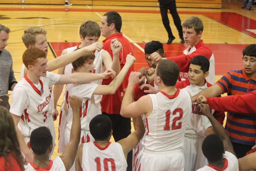The boys basketball team pumps up under the lead of senior captain Charlie Volpe.