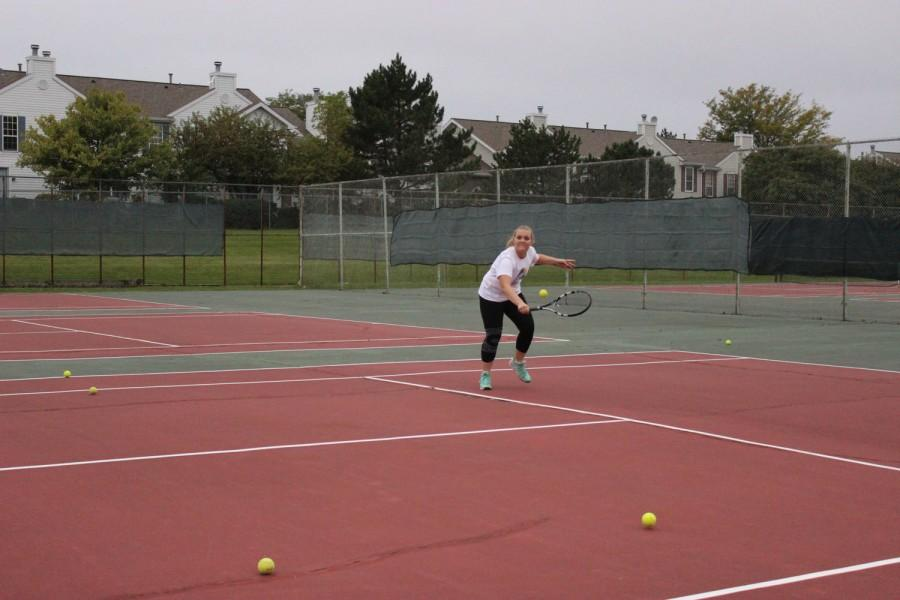 Junior Jessica Peterson practices her backhand.