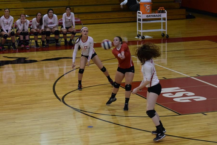 Senior Julia Harbison bumps the ball back to her teammates.