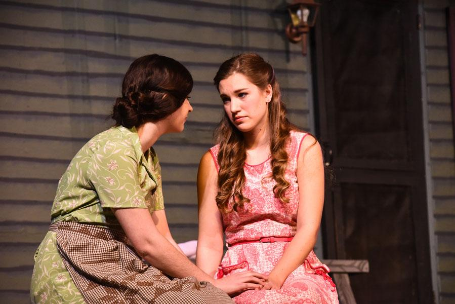 Junior Payton Cousins (left) and Senior Marisa Nuzzo (right) share a moment on stage as Flo and Madge Owens in MHS' 'Picnic'.