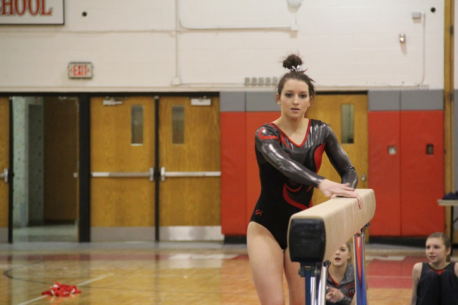 Junior Taylor Shanahan practices on beam. She competed in all-around and bar at the State meet.