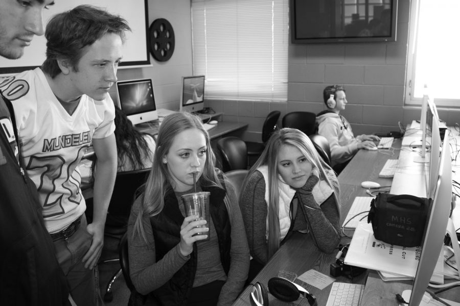 Students in the TV apprenticeship class prepare for the Friday Focus.