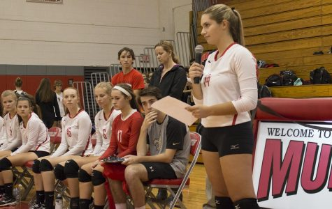 Senior Juila Loverde reads a speech before the volleyball game in remembrance of Mrs. Craven.