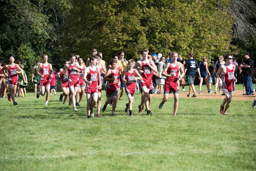 The boys cross country team races to win.