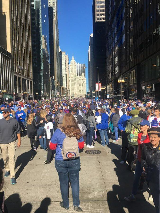 Masses of Cubs fans crowd the streets, making their way towards the celebration rally held at Grant Park.