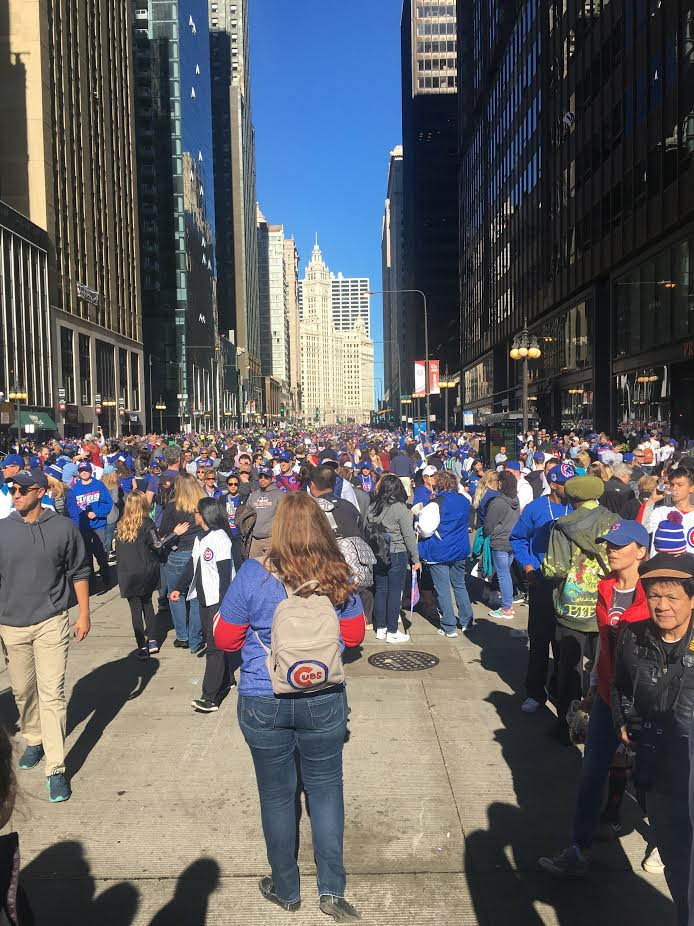 Masses+of+Cubs+fans+crowd+the+streets%2C+making+their+way+towards+the+celebration+rally+held+at+Grant+Park.