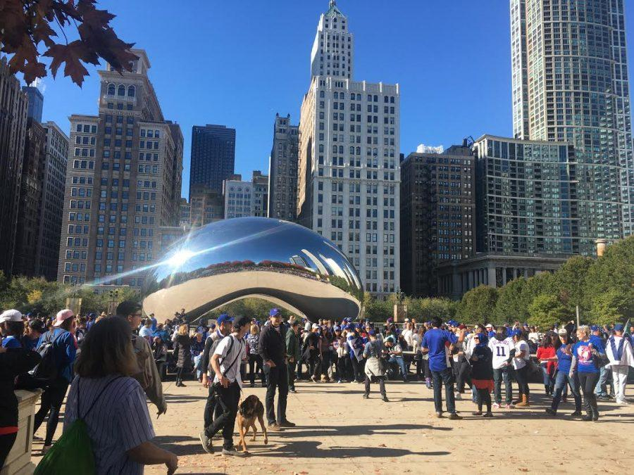 After the victory parade, fans gather around The Bean to take pictures. The Bean was closed off during the celebration, most likely in order to avoid damage.