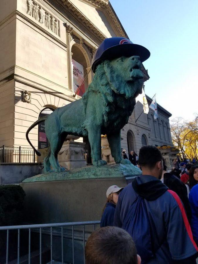 Lion statues in front of The Art Institute of Chicago dressed up with Cubs batting helmets to celebrate the win.