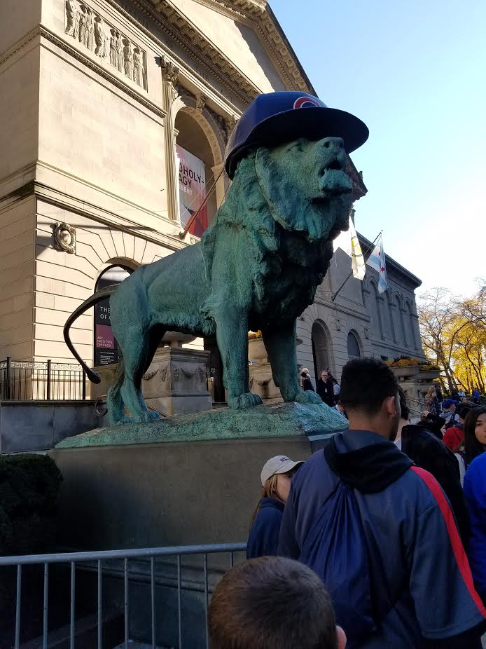 Lion+statues+in+front+of+The+Art+Institute+of+Chicago+dressed+up+with+Cubs+batting+helmets+to+celebrate+the+win.