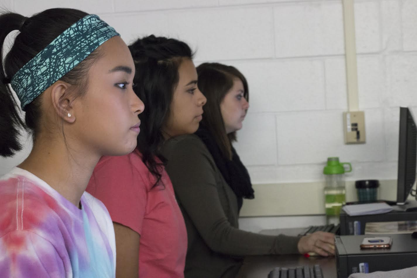 Seniors (left to right) Mariah Tarnate, Stephanie Villagomez and Jessica Milam make the best of having no off-periods by taking a digital photo design class.