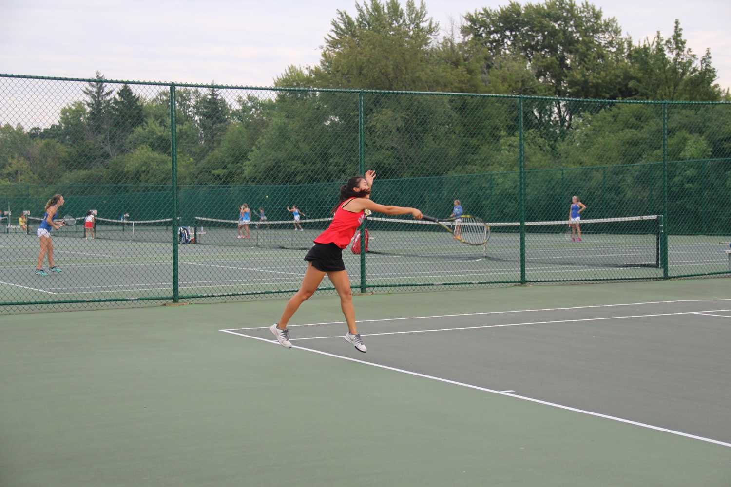 Junior Bree Park implements time management strategies to help her balance school work with her sports commitment on the tennis team.