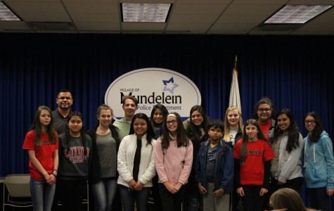 Members of the Mundelein After School Coalition pose together before participating in their turkey delivery event.