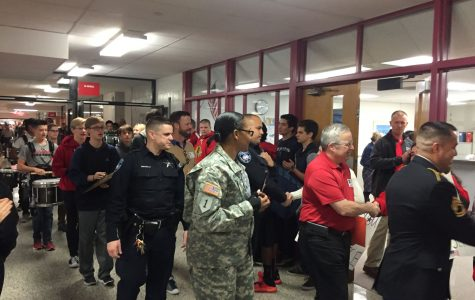 Staff and students greet Veterans as they enter the building on Veterans day. The MHS Marching Band led a parade of Veterans around the school in honor of their service and sacrifice.