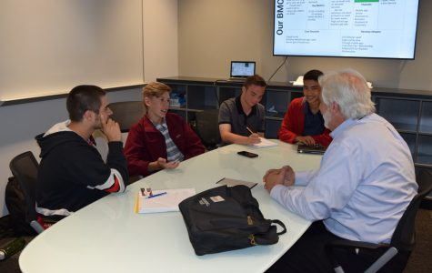 Members of Dapper Car Wash meet with their mentor during first period of Business Incubator. Photo courtesy of Amy Amber