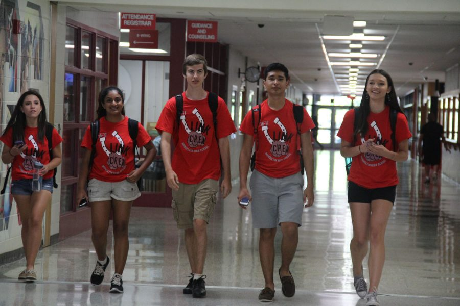 Link Crew members show off their t-shirts on the first day of school.