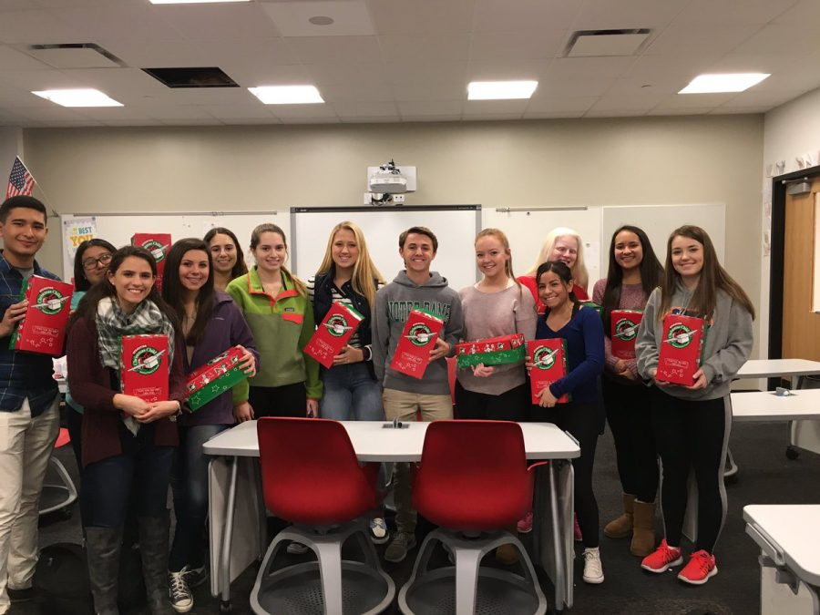 Senior and Freshman class help pack boxes for Operation Christmas Child.