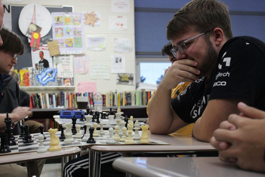 Senior Kobi Krehmeyer plans his next move at chess club.