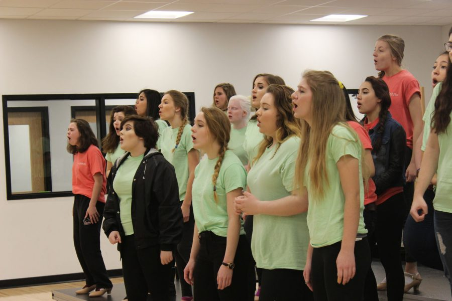 Students in the Lights  all female show choir rehearsing for competition.