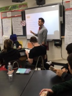 Ryan Buck lectures his first period honors English 3 class regarding grades.