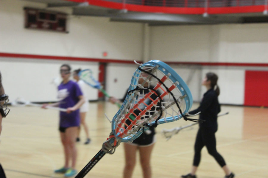 Girls lacrosse practicing at one of their first practices of the season on March 6.