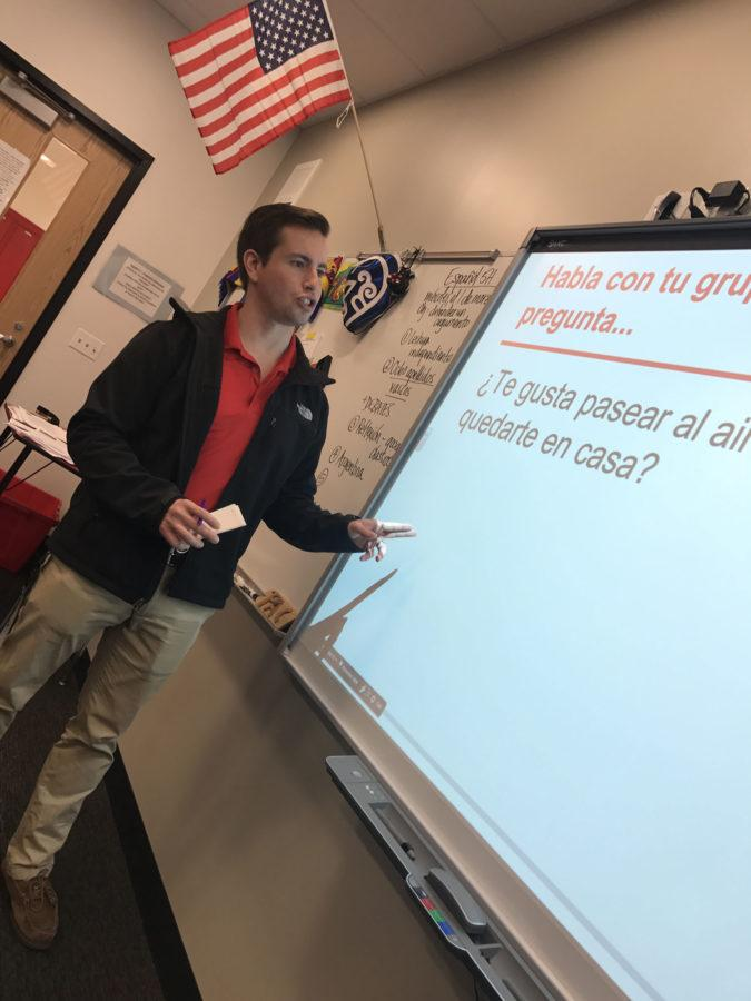 Spanish Teacher Brian Packowitz presents his question of the day on the board for his Spanish heritage 3 class.
