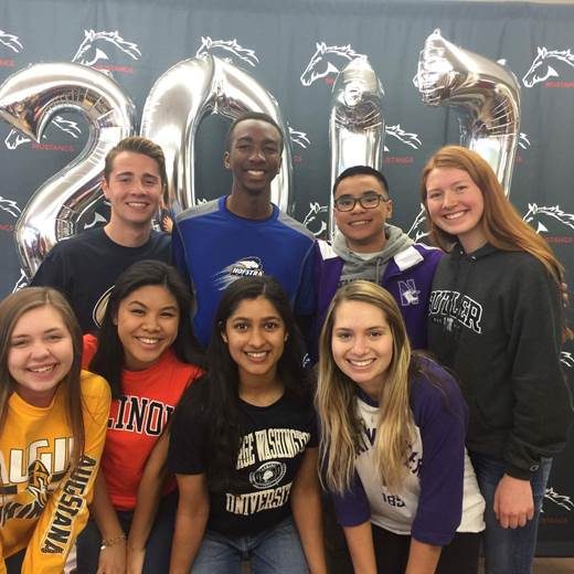 ITS OFFICIAL:  At the Decision Day celebration, the NHS Executive Board represents their future schools while mingling with friends who also made their college or career choice official. They were among many other seniors that did not miss the chance to take photos, enjoy Dunkin Donuts, and win prizes.