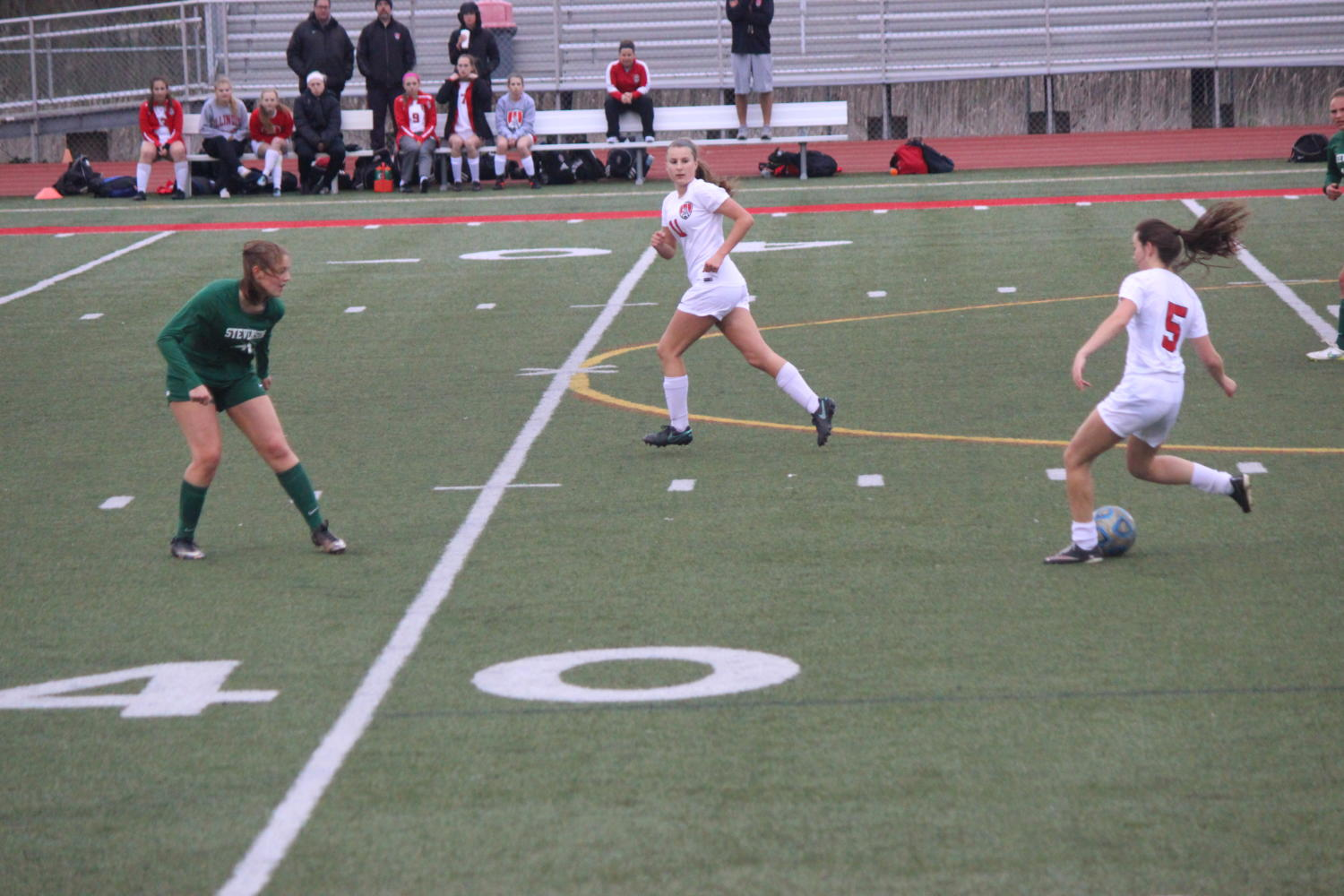 Thread the Needle: Senior Midfielder Emily Ollendick looks to pass ahead of the Stevenson defender to Junior Forward Myah Strokosch in order to get a scoring chance.