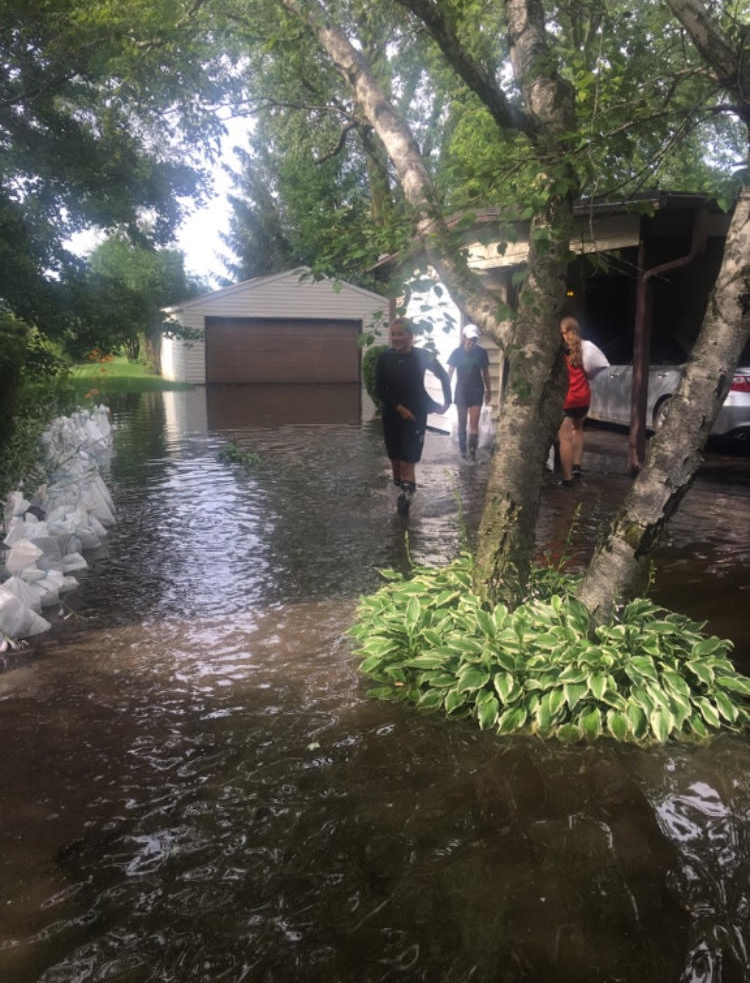 Photos outside Madison Parola's home the morning after the flood.