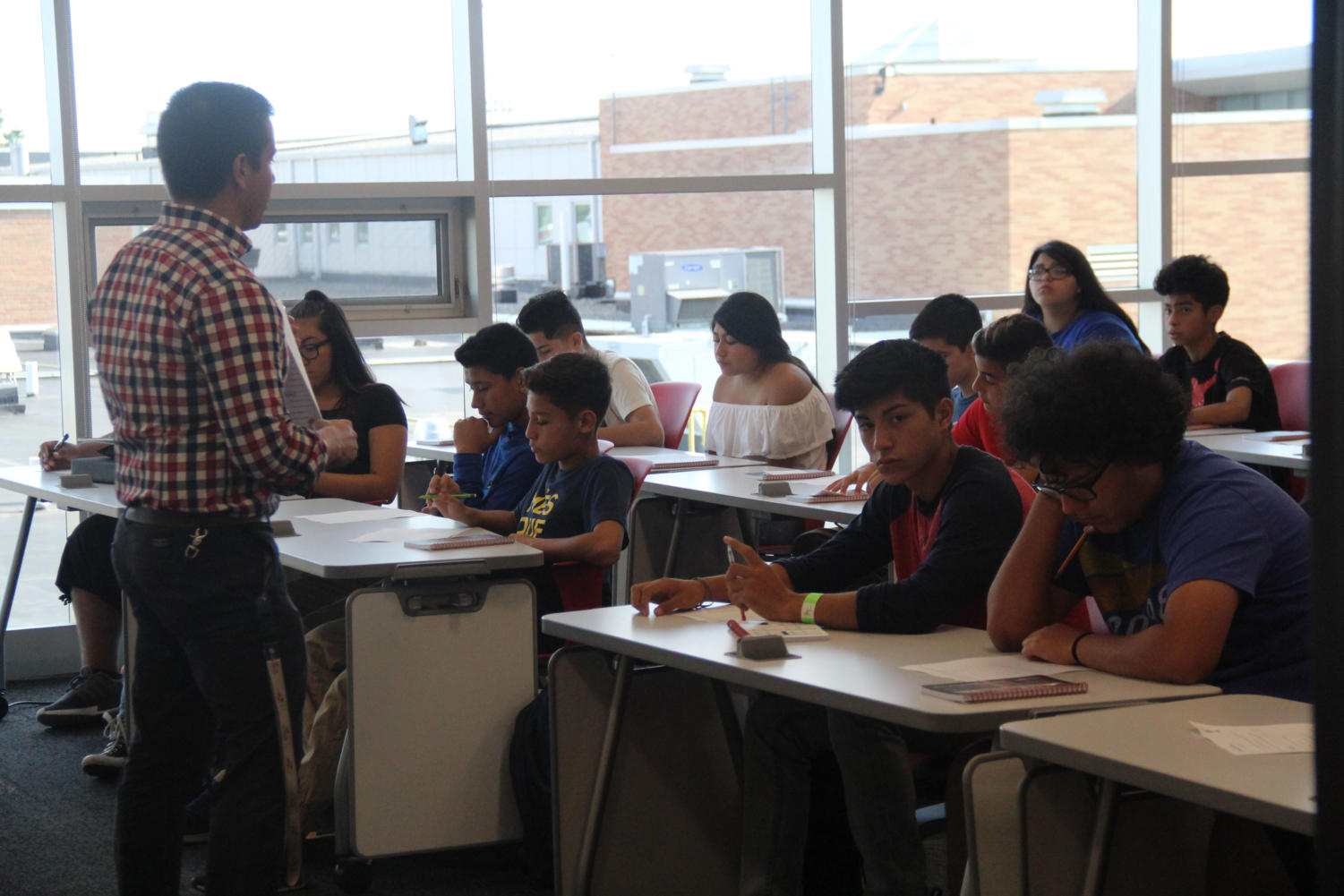 Spanish teacher Brian Packowitz lectures Spanish class as students look on and take notes