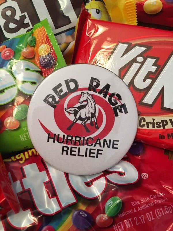 Red Rage selling candy and pins for hurricane relief. Photo submitted by Emily Olson