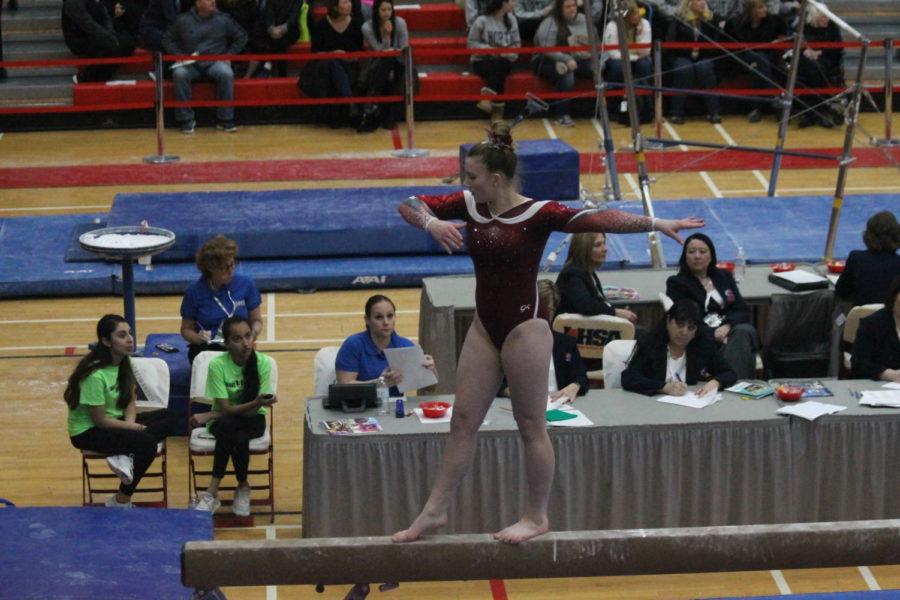 Freshman+Emma+Hallin+performs+her+beam+routine+at+the+2018+IHSA+State+Gymnastics+meet.