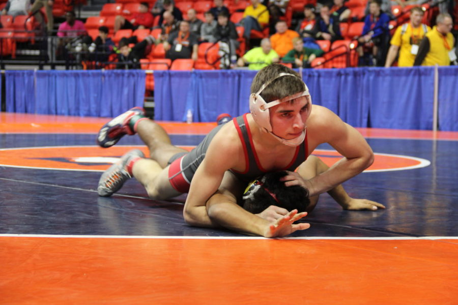 Determination%3A+Senior+Dane+Durlacher+strives+to+win+his+first+constellation+match+at+106+pounds+after+losing+in+his+quarterfinal+match+against+Nain+Vazquez+of+Montini+High+School.+Durlacher+won+with+a+decision+of+11-4+against+sophomore+Dylan+Amico+of+Plainfield+North+High+School+during+his+time+at+the+IHSA+Individual+State+tournament+at+the+State+Farm+Center+at+the+University+of+Illinois+in+Champaign.