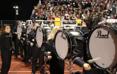 At the football game on Aug. 28, the MHS Drum Line, which is part of the Marching Band, performed during the action taking place on the field.