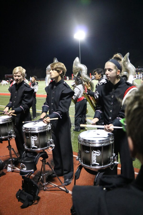 Senior+Jillian+Hoffstadt+plays+her+drums+to+the+beat+of+a+song+at+a+football+game+during+the+2018+fall+season.