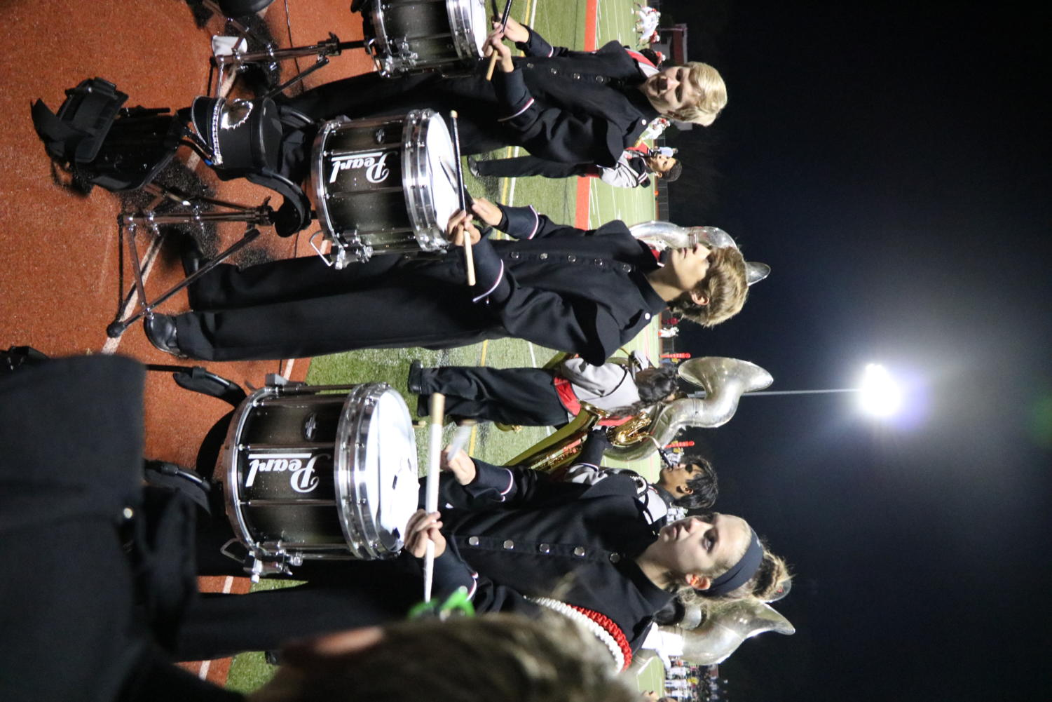Pictured is senior Jillian Hoffstadt as she plays her drums to the beat of a song at a football game during the 2018 fall season.