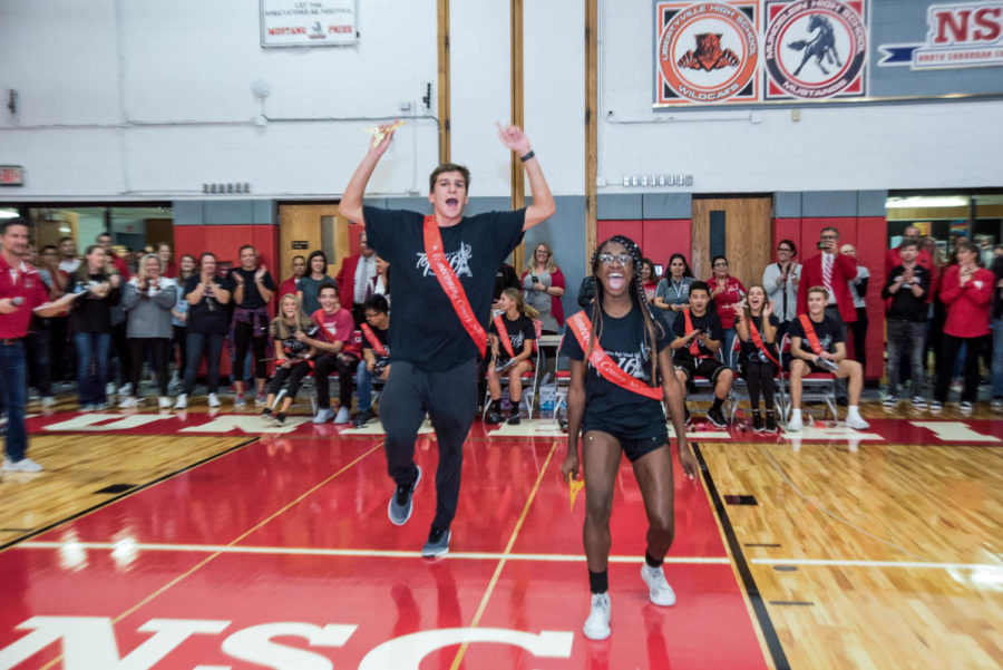 Seniors Jake Garcia and Khari Thompkins jump with joy when they found out they were named the 2018 Homecoming king and queen.