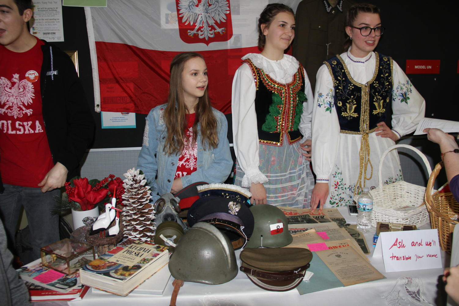 Cultural+Artifacts%3A+Juniors+Maya+Skowronski%2C+Marta+Sikora+and+Claudia+Kuran+%28far+left%29+display+military+helmets%2C+books+and+floral+artifacts++from+Poland.