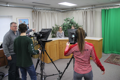 Medium+Shot%3A+Advanced+Media+Teacher+Kent+Meister+directs+Junior+Josh+Fordham+and+Sophomore+Elle+Mishler+on+what+shots+to+capture.+To+produce+the+newscast%2C+the+students+use+two+professional+cameras%2C+which+are+similar+to+cameras+used+in+actual+television+productions.+Kimi+Vargas%2C+senior+and+three-year+veteran+of+the+class%2C+said%2C+%E2%80%9CThe+camera+work+can+be+some+of+the+trickiest+on+the+set+but+is+usually+forgotten.+It%E2%80%99s+important+to+make+sure+to+get+the+perfect+shot+for+the+production+to+come+together.%E2%80%9D+