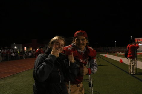 Senior Zoe Palm, a student athletic trainer intern, and Senior Drake Morton are all smiles at the last home football game on Oct. 18.