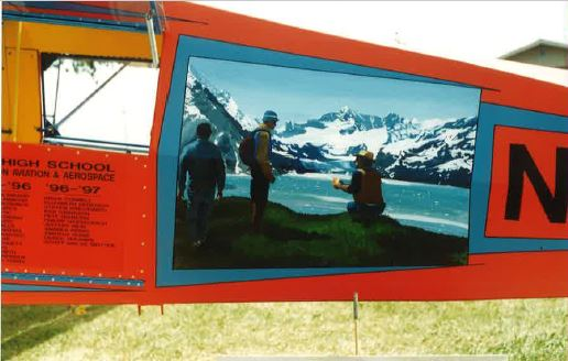 Near the tail end of the Montana Coyote, an aircraft designed for off-airport use, a mural created by the art program is displayed. The plane was completed in 1998.