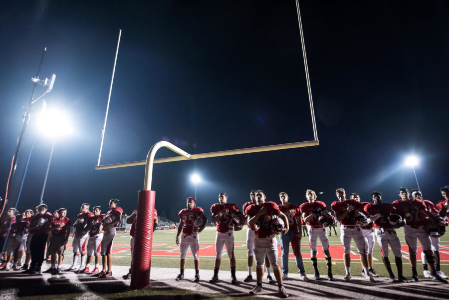 Gearing+up%3A+On+the+night+of+the+homecoming+football+game%2C+the+varsity+football+team+stands+shoulder-to-shoulder+during+the+National+Anthem.+With+a+29-14+win+against+Waukegan+High+School%2C+many+of+the+players+were+proud+to+show+Mustang+Nation+their+dedication+and+capabilities+on+the+field.+%E2%80%9CWe+are+all+a+tight+group+of+guys+who+live+and+breathe+football%2C%E2%80%9D+junior+Alex+Wing+said.+%E2%80%9CWe+all+support+each+other+and+want+the+best+for+every+one+of+us.%E2%80%9D