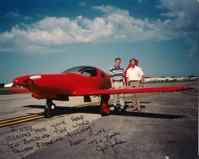 Vocational Education Teacher James Jackson and Tom Zentz (Class of 1988) stand in front of the record-breaking Lancair 360, which flew to the Arctic Circle and back in 1995. This particular picture was addressed to Andrew Zimmermann (Class of 1991), who helped build its ailerons.