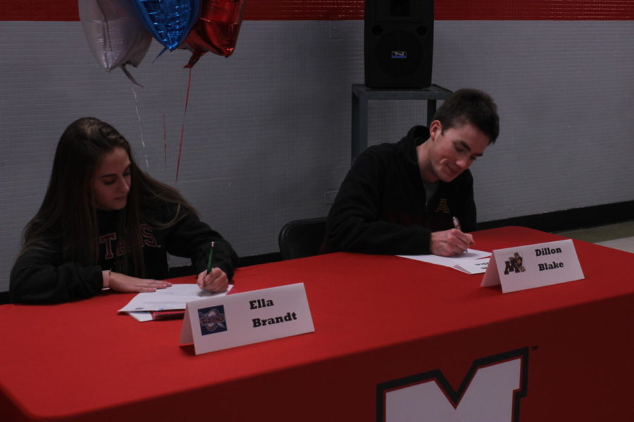 Seniors Elizabeth Brandt and Dillon Blake sign to future colleges to play lacrosse (Brandt) and track and field and cross country (Blake).