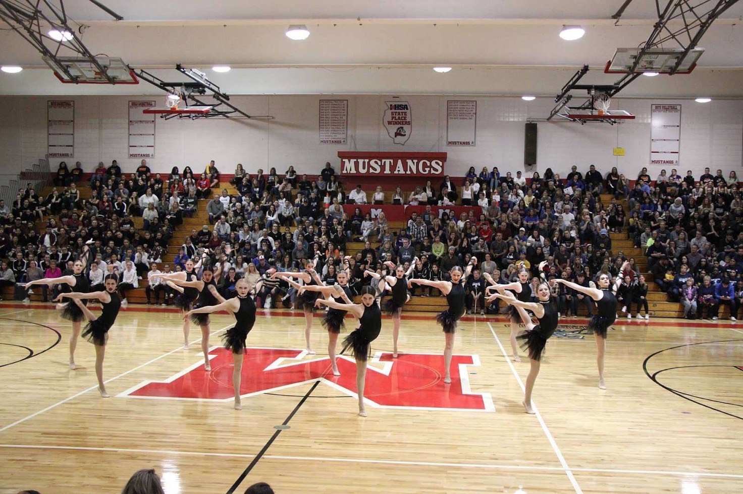 """Mundelein's varsity dance team got seventh place at the """"We Came to Dance"""" invitational hosted at MHS on Nov. 24, for its dance to """"Hold Back the River"""" covered by Blaine Mitchell."""