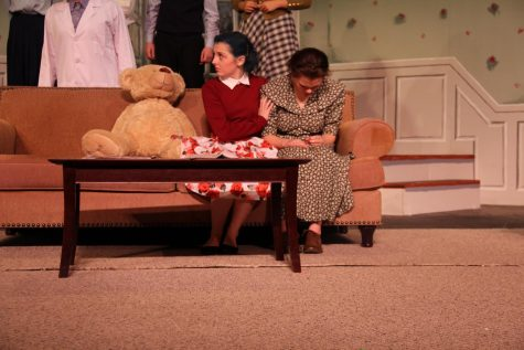 "In the winter play ""Curious Savage,"" Mrs. Savage , played by senior Katie Staroszyck comforts Mrs. Paddy, who was played by senior Paige Steiner."