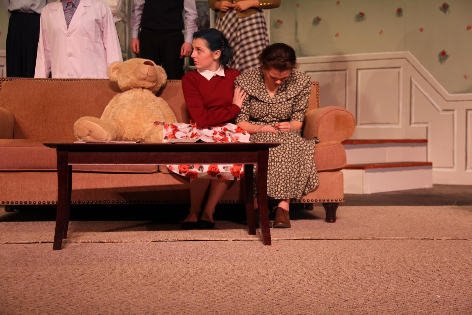 """In the winter play """"Curious Savage,"""" Mrs. Savage , played by senior Katie Staroszyck comforts Mrs. Paddy, who was played by senior Paige Steiner."""