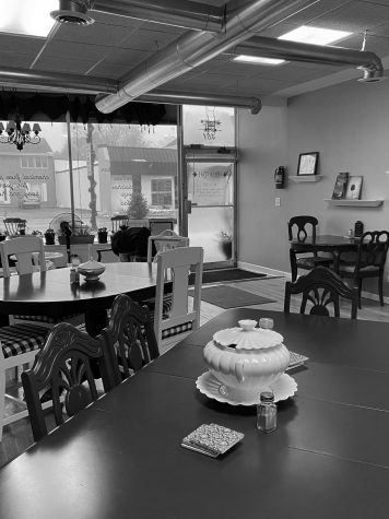 "The inside of Fresh Cafe, owned by Kelly Paulson, features quaint tables, a ""fresh"" atmosphere full of color and carpentry created by her husband. The cafe offers couches and tables for any person, alone or with a group, to enjoy what Fresh Cafe has to offer."