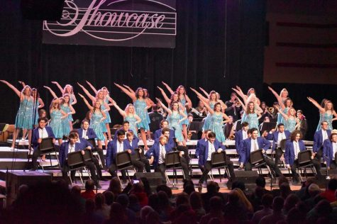 "Sound performs ""Happy Train"" at the Totino Grace Show Choir Spectacular in Minneapolis from March 6-8. The group added a fresh element by dancing with chairs throughout the song."
