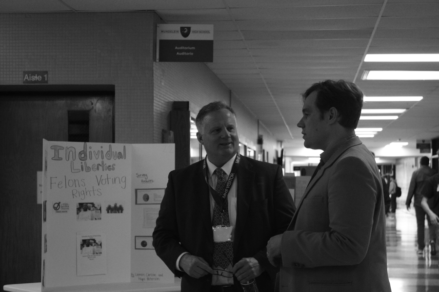 Lake County Circuit Judge Christopher Morozin speaks with a campaign aid for Dr. Tom Tarter, a Republican candidate for U.S. senator, as they tour the Civics Fair held in the Commons by AP Government students on March 5 during the lunch periods.
