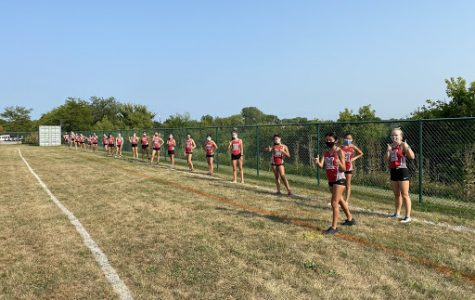 "At the first meet of the season, girls cross country lines up ready to run on Aug. 25 at the Diamond Lake Sports Complex. While meets are more like time trials this season than previous seasons, the girls said they are still excited for the season. Hope Peterson, senior, said, ""We love what we do."""